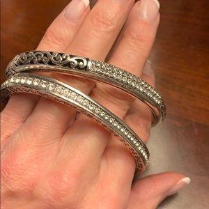 Two Hinged silver and diamond bangle bracelets